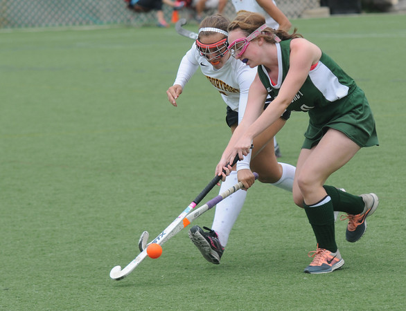 Amesbury: Newburyport's Baily Peyton fights for the ball with Pentucket's Emily Queenan at Amesbury Sports Park in Amesbury. Jim VAiknors/staff photo