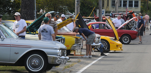 Byfield:Ppeople check out the classic cars at Byfield Days Saturday. Jim Vaiknoras/staff photo