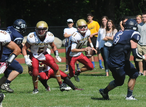 Lynnfield: Newburyport's Michael Shay looks downfield for a reciever at Lynnfield Saturday. jim Vaiknoras/staff photo