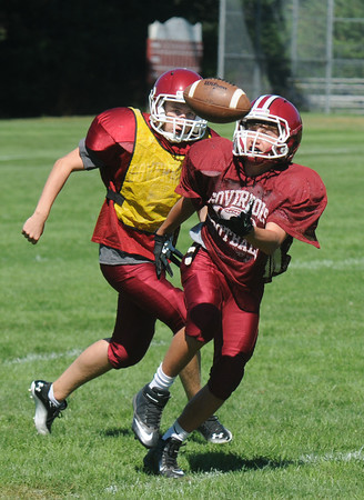 Byfield: The Governor's Academy's Jackson Wotton keeps his eye on the ball at practice friday. Jim Vaiknoras/staff photo
