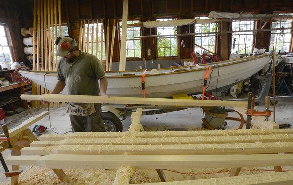 Amesbury: Ben Loveless makes oars at Lowell's Boat shop in Amesbury Monday afternoon. Jim Vaiknoras/staff photo