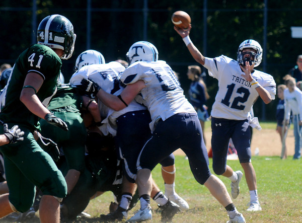 West Newbury: Triton's Bradley Whitman looks downfield for a reciever during the Viking's game at Pentucket Saturday afternoon. Jim Vaiknoras/staff photo