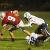 Amesbury: Amesbury's Pat Scanlon breaks a tackle against Triton at Landry Stadium in Amesbury Friday night. Jim Vaiknoras/staff photo