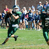 West Newbury: Pentucket's Ryan Kuchar looks down field for a reciever during the Sachem's game against Triton at Pentucket Saturday afternoon. Jim Vaiknoras/staff photo