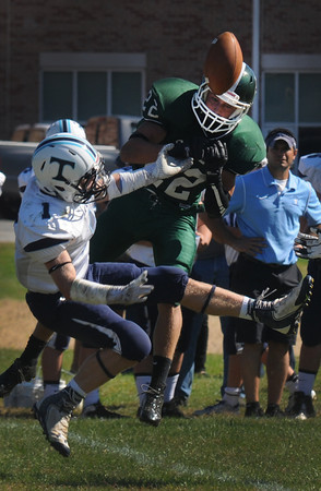 West Newbury: Pentucket's Jeff Porter breaks up a pass intended for Triton's Justin Cashman during their game at Pentucket Saturday afternoon. Jim Vaiknoras/staff photo