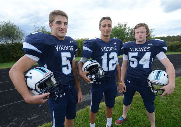 Byfield: Triton Football Captains, Justin Spillane, Bradley Whitman, and Patrick Moran. Jim Vaiknoras/staff photo