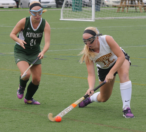 Amesbury: Newburyport's Meghan Bragole clears the ball under pressure from Pentucket's Colleen Mulholland at Amesbury Sports Park in Amesbury. Jim VAiknors/staff photo