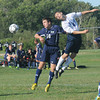 Byfield: Triton'sEric Rybicki heads a ball with Hamilton-Wenham's Jared Bean during their game at Triton Friday afternoon. Jim Vaiknoras/staff photo