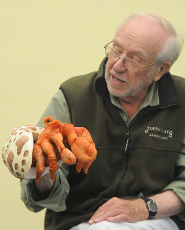 Newburyport: Volunteer Victor Atkins uses a puppet to teach about hermet crabs at the Seacoast Carnival Free-for-all at the Joppa Flats Education Center Sunday morning. Jim Vaiknoras/staff photo