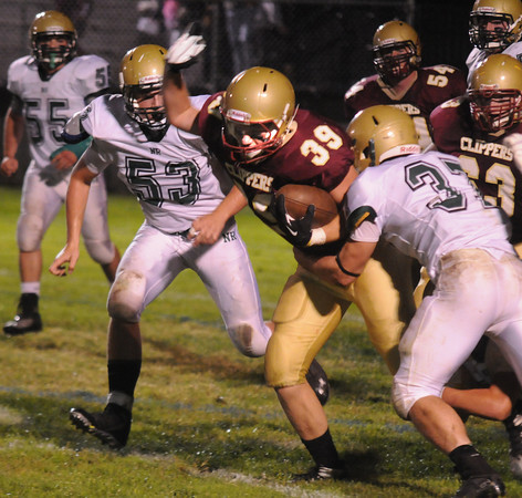 Newburyport: Newburyport's Jacob Timony fights for yardage during the Clipper's home game against North Reading Friday night. Jim Viknoras/staff photo
