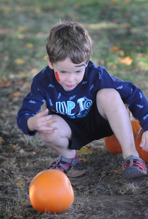 Newbury: Jack Watson Milton, 4, of Dover bowls with a pumpkin at the American Music and Harvest Festival at the Spencer Peirce-Little Farm in Newbury Sunday. Jim Vaiknoras/staff photo