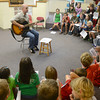 Newbury: David Williams, a 4th grad teacher at Newbury Elementary , sings      The Ballad of Johnny Appleseed, a song he wrote, with the four 3rd grad classes  at the school Friday. The classes were learning about and celebrating Johnny Appleseed. Jim Vaiknoras/staff photo