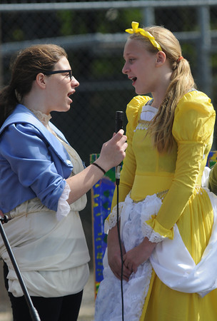 Jim Vaiknoras/staff photo.Molly Lesnever as The Beast and Chloe Webster as Belle of the Acting Out Theater group perform at Groveland Days Saturday at the Groveland Recreation Fields.
