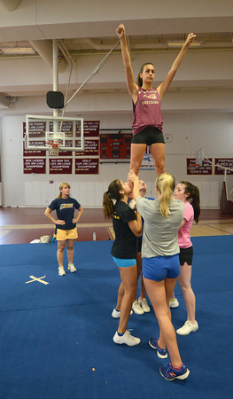 Newburyport: New Clipper cheerleading coach Nadine Holohan works with the team in the high school gym. Jim Vaiknoras/staff photo