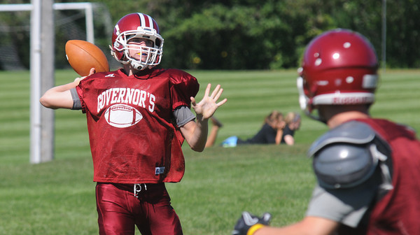 Byfield: The Governr's Academy's Seth Harrell looks for a reciever at practice friday. Jim Vaiknoras/staff photo