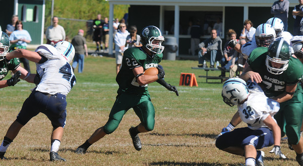 West Newbury: Pentucket's Jeff Porter turns upfield during the Sachem's game against Triton at Pentucket Saturday afternoon. Jim Vaiknoras/staff photo