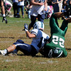 West Newbury: Pentucket's Jeff Porter is upended by Triton's James Wood during their game at Pentucket Saturday afternoon. Jim Vaiknoras/staff photo