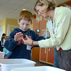 Newburyport: Liam Childs and his mom Hilary Graham check out a sea urchin crabs at the Seacoast Carnival Free-for-all at the Joppa Flats Education Center Sunday morning. Jim Vaiknoras/staff photo