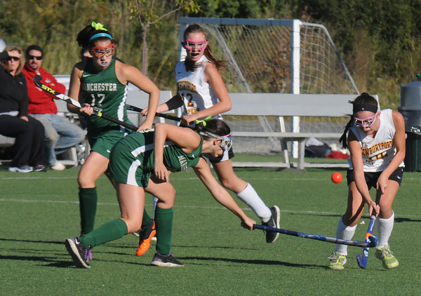 Amesbury: Newburyport's Meghan Bragole fights for the ball with Manchester Essex player Rachael Gallagher during their game at Amesbury Sports Park Thursday. Jim Vaiknoras/staff photo