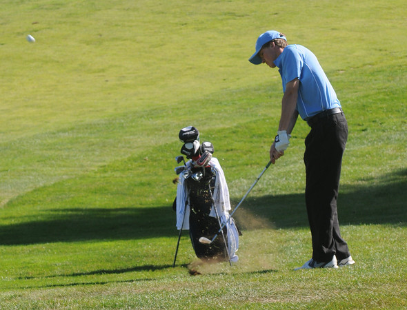 newbury: Triton's Jon Seward with his approach on the 2nd hole at Ould Newbury during the Viking's match against North Reading. JIm Vaiknoras/staff photo