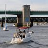 newburyport: Boaters head up river towards the Gillis Bridge late Sunday afternoon. Jim Vaiknoras/staff photo