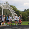 Byfield: Members of the Triton girls soccer team carry the goal to practice Monday afternoon. Jim VAiknoras/staff photo