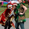 Jim Vaiknoras/staff photo. Brinn Kingslaey as Pan and Dave Cook as Captain Hook of The Acting Out Theater group perform at Groveland Days Saturday at the Groveland Recreation Fields.