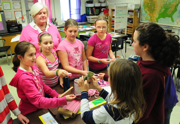 Newburyport: A team of students wearing pink in Carol Snow's class at the Upper Molin sell wristbands and pencils. Bryan Eaton/Staff Photo