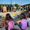 Groveland: Youngsters sit on the roadway yesterday,  where traffic will be heading over today, at state Sen. Bruce Tarr welcomes those to the dedication ceremony of the new Bates Bridge. Bryan Eaton/Staff Photo