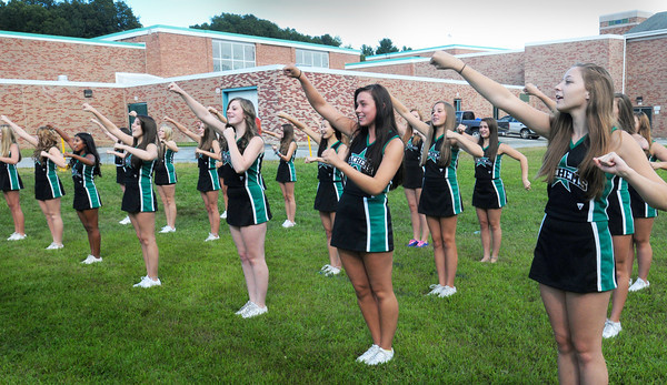 West Newbury: The Pentucket High School football cheerleaders practice a cheer on Thursday afternoon. They were waiting their turn to have a team picture in the sports section of the yearbook and football program. Bryan Eaton/Staff Photo