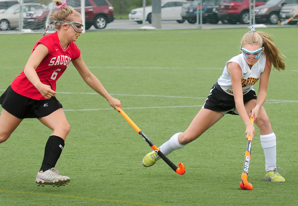 Amesbury: A Saugus player moves in on Newburyport's Molly Stanton. Bryan Eaton/Staff Photo