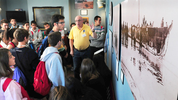 "Newburyport: Fran Larkin, a docent at the Custom House Maritime Museum in Newburyort, shows exhibits in the ""shipwreck room"" on Tuesday, a photo of the Jennie M. Carter that sank on Salisbury Beach in the 1890's. The students, from Spain, were staying with local families and were heading in to Fenway Park for a tour afterwards, though they won't see any Red Sox as they're in Colorado. Bryan Eaton/Staff Photo"