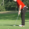 Amesbury: Amesbury golf co-captain Jack Cashman putts in action with Triton yesterday.  Bryan Eaton/Staff Photo