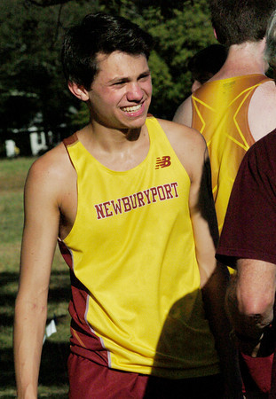 Newburyport: Newburyport cross country runner Nick Carleo smiles as he's congratulated on a new course record yesterday at Maudslay State Park. Bryan Eaton/Staff Photo