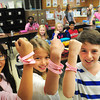 Newburyport: Upper Molin School students will be selling these wristbands-which say Strength, Hope and Faith-for a dollar to raise money for breast cancer awareness. From left, Kati Casey, SIdney Ficht and Stephen Jean, all 11. Bryan Eaton/Staff Photo