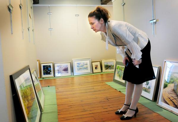 Newburyport: Lauren O'Neal checks out photos for the Fall Members Juried Show at the Newburyport Art Association. Bryan Eaton/Staff Photo