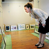 Newburyport: Lauren O'Neal checks out photos for the Fall Members Juried Show at the Newburyport Art Association. Bryan Eaton/Staff Photo