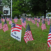 Salisbury: The Salisbury Chamber of Commerce planted several dozen American Flags on the town common, with signs donated by Seaport Signworks, to honor the lives lost in the 911 attacks on the United State twelve years ago. Bryan Eaton/Staff Photo