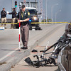 Hampton: New Hampshire State Police collision reconstruction team take measurements on the Underwood (Hampton) Bridge after a car hit several bicyclers participating in ride. Two were reported dead and three were injured. Bryan Eaton/Staff Photo