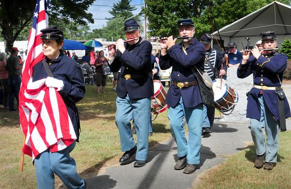 Salisbury: The Bostonia Allarum Fife and Drum Corp march to the veteran's memorials in Salisbury Square on Saturday. Bryan Eaton/Staff Photo