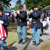 Salisbury: The Bostonia Allarum Fife and Drum Corp march to the veteran's memorials in Salisbury Square on Saturday. Bryan Eaton/Staff Photo