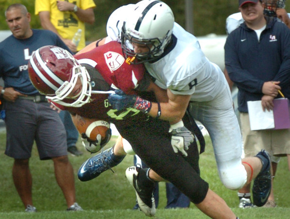 Byfield: A Lawrence Academy player takes down Governor's Academy Andrew Bug Carper after gaining a good amount of yardage on Saturday. Bryan Eaton/Staff Photo