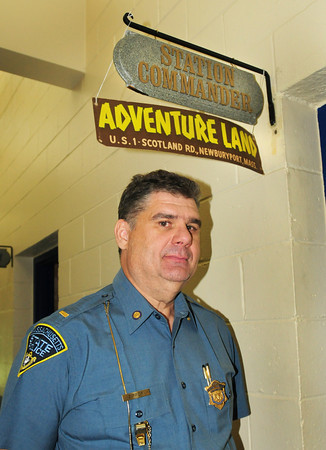 Newbury: Newbury State Police station commander Lt. Paul Zipper has a sign of Adventure Land over his office someone picked up at a yardsale. Bryan Eaton/Staff Photo