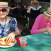 "Newburyport: Marjorie McVeigh, left, and Helena Earle dine on corn, hot dogs, grilled chicken and watermelon at a cookout Wednesday at the Brigham Manor in Newburyport. They have a cookout for the residents every two weeks starting in June with this one being their ""swan song"" for the year. Bryan Eaton/Staff Photo"