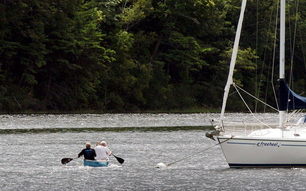 Amesbury: A couple paddle their canoe out from the Amesbury town launch near Larry's Marina on Thursday as the clouds began to break. Sun is in the forecast for the weekend with a chance of a spot shower on Sunday. Bryan Eaton/Staff Photo