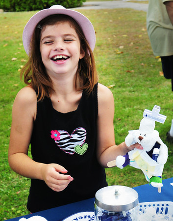 Salisbury: Olivia Rowe, 9, of Salisbury has fun at the Teddy Bear Booboo Clinic sponsored by Children's Health Care at the Anna Jaques Hospital. Bryan Eaton/Staff Photo