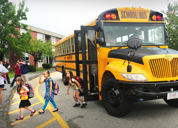 Amesbury: Students jump off the bus at Amesbury Elementary School as classes started in that town and the Triton School District as well on Tuesday. Bryan Eaton/Staff Photo