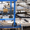 Salisbury: Woody Delgado of Newburyport motors his 38' sailboat under a lift to be taken out of the Merrimack River for the season at Bridge Marina in Salisbury. Bryan Eaton/Staff Photo