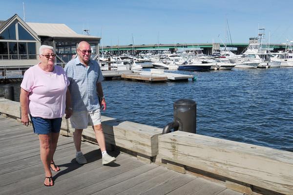 Newburyport: Gerri Beck and her husband, Jack, walk along Newburyport's waterfront boardwalk. Bryan Eaton/Staff Photo