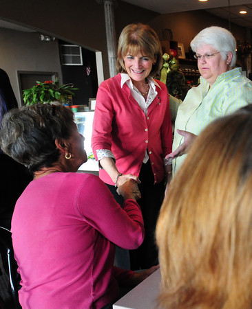 Newburyport: Wimberley Burton, right, of Haverhill introduces Attorney General Martha Coakley to Hilde Champion, Newburyport, left, and Gerry Heavey, back to camera, from Byfield at Cafe Di Siena. Coakley who's running for governor made informal stops there and at Angie's Foods. Bryan Eaton/Staff Photo